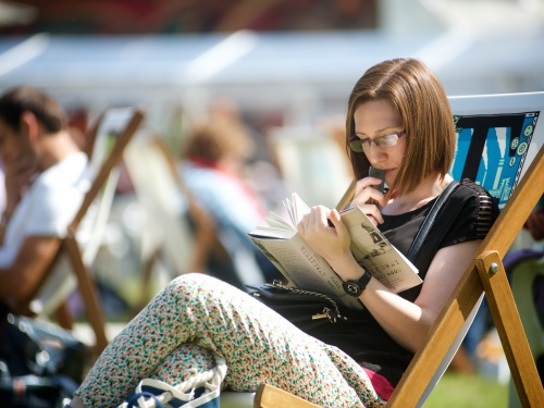 Reading in the sunshine at the edinburgh international book festival about listing