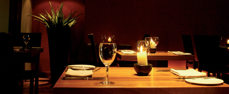 An image of a table laid for dinner at David Bann
