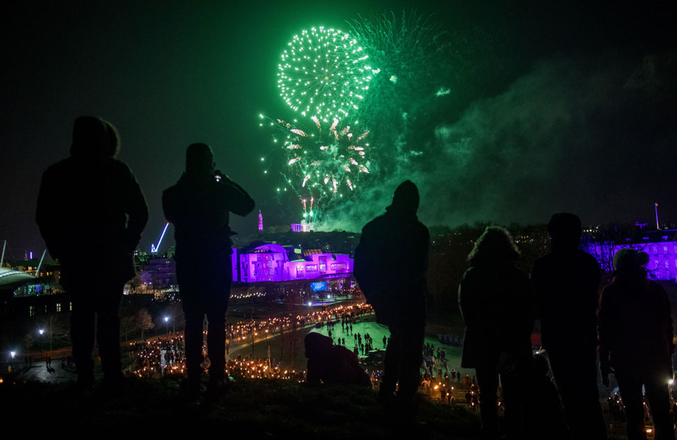 Torchlight Fireworks from Salisbury Crags at Edinburghs Hogmanay photo Ian Georgeson 4