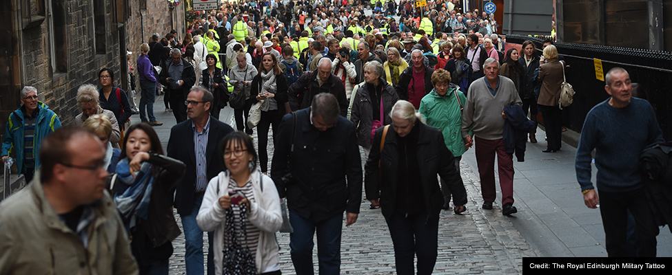 Photo: A crowd of people walking up the cobbled streets of Edinburgh towards the Royal Edinburgh Military Tattoo
